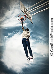 Basketball Player - A basketball player drives to the hoop...
