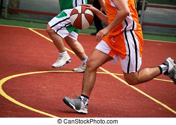 basketball player - Basketball player running with ball in...