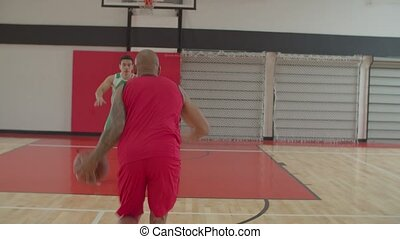 Basketball player committing offensive foul of charging - ...