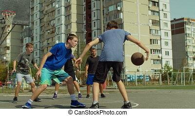 Basketball player dribbling between legs on court