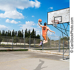 player dunking in a playground