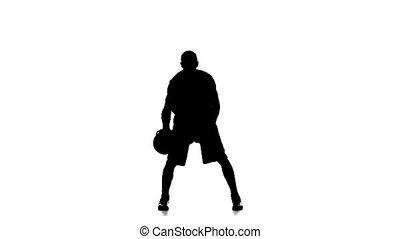Basketball Player Fills The Ball. Slow Motion. Silhouette. White Background