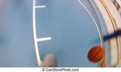 Basketball player goes to basket and throws there ball. -...