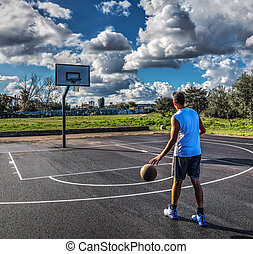 Basketball player in a playground