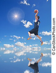 basketball player in the sun reflected in the water