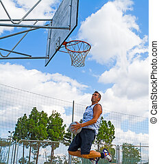 basketball player jumping to the hoop