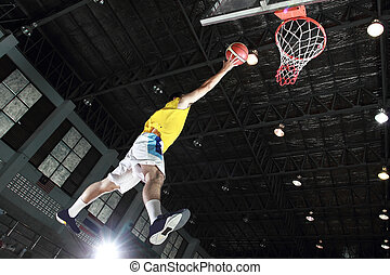 Basketball player layup for score in the game