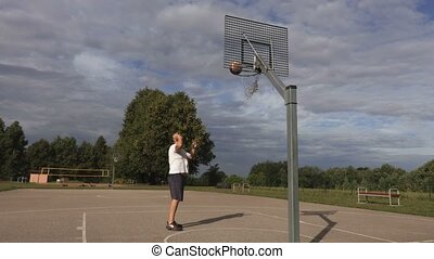 Basketball player perfectly throw ball in basket