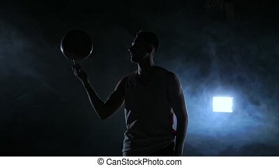 Basketball player performing different tricks and spinning...