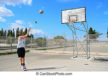 basketball player practicing jump shot