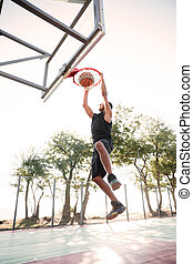 Basketball player practicing outdoors