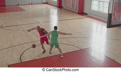 Basketball player scoring points after layup shot - Athletic...