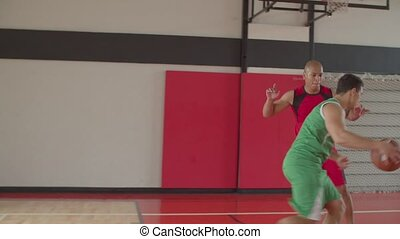 Basketball player shooting ball to score pooints - Skillful ...