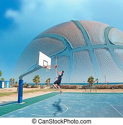 basketball player shooting by the sea