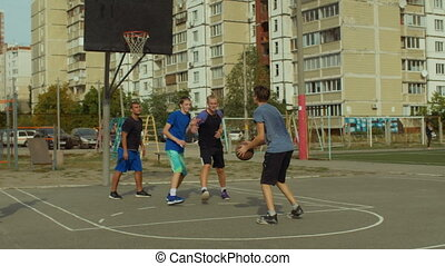 Basketball player shooting for field goal on court