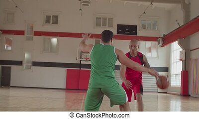Basketball player shoots for two-point field goal - ...