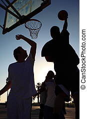 Basketball player silhouette at sunset