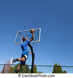 Basketball Player Slam Dunking - Young basketball player...