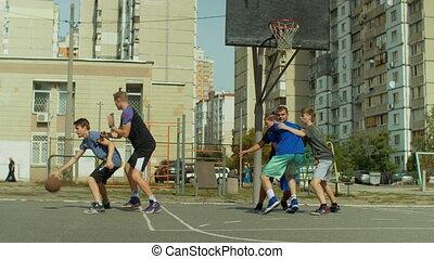Basketball player taking jump shot on court