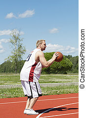 Basketball player with the ball