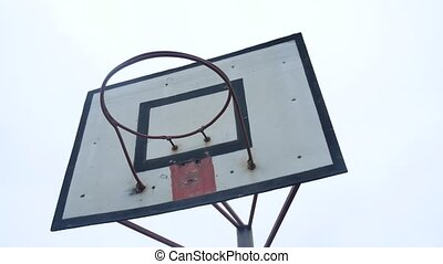 Basketball ring on an old wooden shield with shabby paint