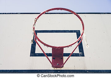Basketball ring without net at daytime