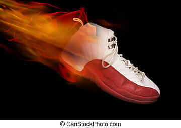 Basketball shoe on fire on black background.
