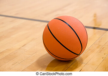 Basketball - Single basketball on hardwood court