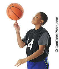 Basketball Spinner - A preteen boy happily spinning his ...