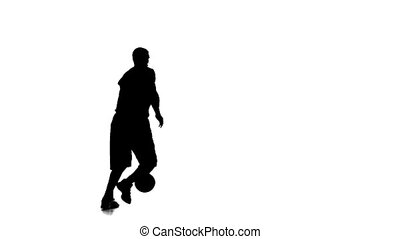 Basketball spinning in a circle and passed the ball to himself. Silhouette