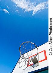 Basketball stands under blue sky