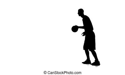 Basketball stuffing the ball and let him go. Silhouette. White background