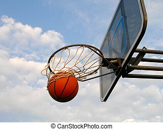 A basketball swishes through the hoop.