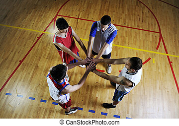 basketball team holding together representing team spirit