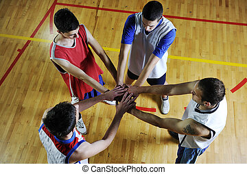 basketball team holding together representing team spirit