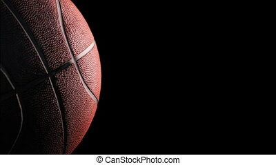 Basketball - Rotation on black background, loop