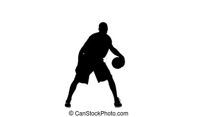 Basketball worth stuffing the ball under his foot. White background. Slow motion
