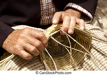 basketry craftsman hands working in Mediterranean basket Ibiza Balearic island