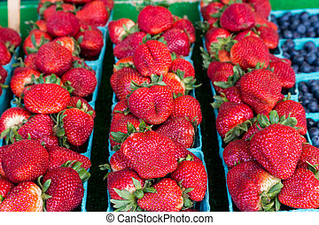 Baskets of Fresh Strawberries in a Market