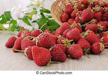 Baskets of strawberries sprinkled on the table close-up