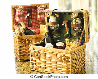 Baskets - Two wicker gift baskets with wine bottles and wine...