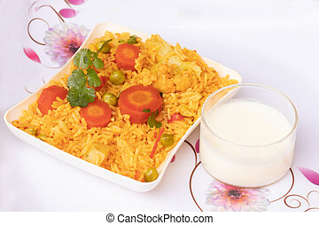 Basmati rice vegetable pulao served in plate with curd