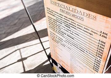 Basque pintxos price tag from a street bar.
