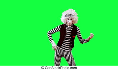 Mime playing a bass guitar. his clip is pre-matted with an embedded alpha-channel. It can be composited over any background.