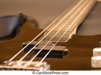 Bass guitar - View of a bass guitar on a plain