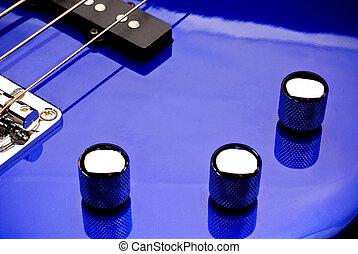 Bass guitar volume and tone knobs - Macro of Bass guitar...