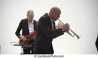 Bass guitarist and trumpeter play in a jazz band