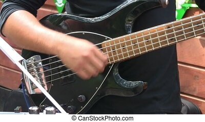 Bass guitarist playing at live rock