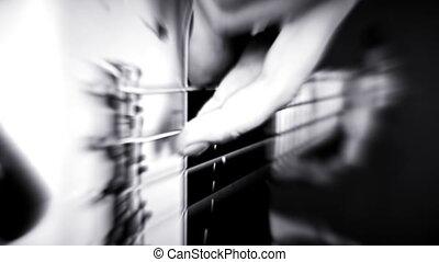 Bass Guitarist Playing Bass Guitar. Bursting Lights and Blured Video