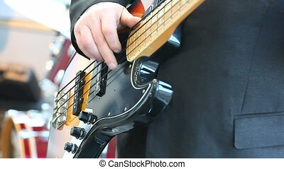 bass guitarist plays on the jazz concert